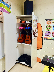 Ukulele Storage Rack in Closet by Charles Van Deursen