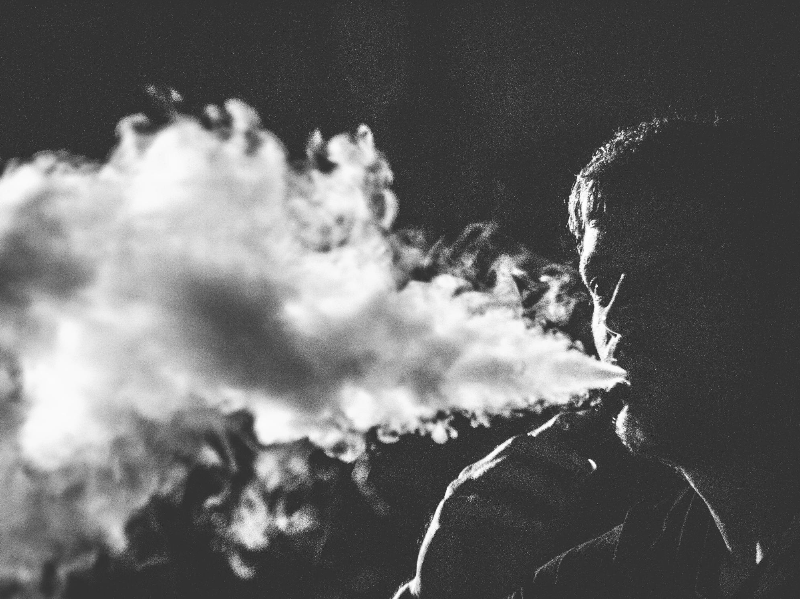 Blowing Smoke Photo by Rubén Bagüés on Unsplash