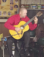 Charles Van Deursen Entertaining a Christmas Party on the Classical Guitar. www.InTuneWithYou.com